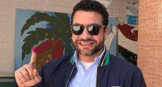 هشام العامري عضو مجلس الأهلي السابق يدلي بصوته في انتخابات الرئاسة