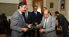 بنك ناصر خلال توقيع الإتفاق