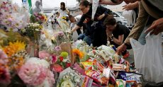 مئات اليابانيين يشاركون فى تأبين ضحية حادث الطعن بطوكيو