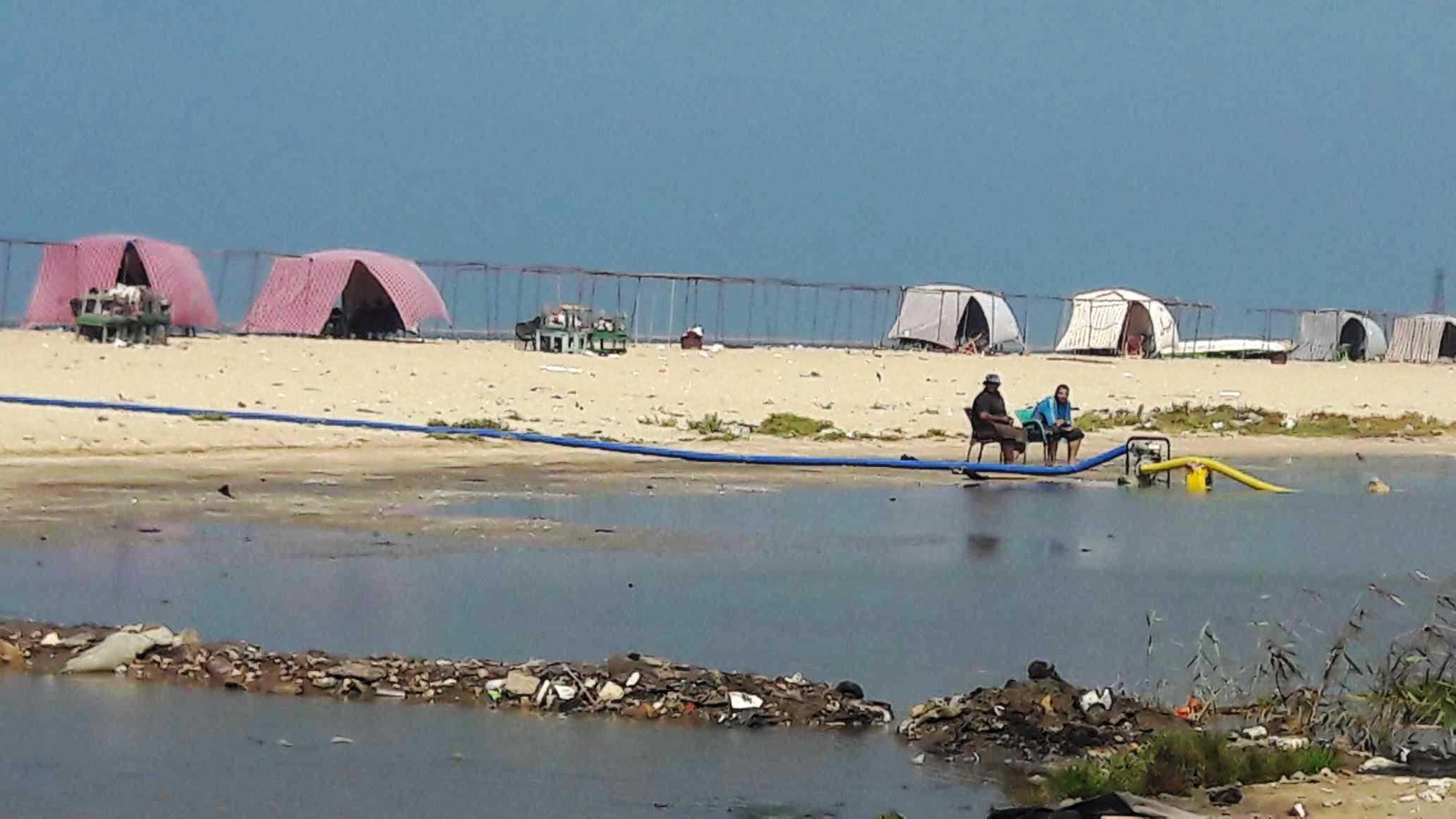 أضبط مخالفة  كارثة  مياه المجارى تصب فى شاطئ بورفؤاد ...  (7)