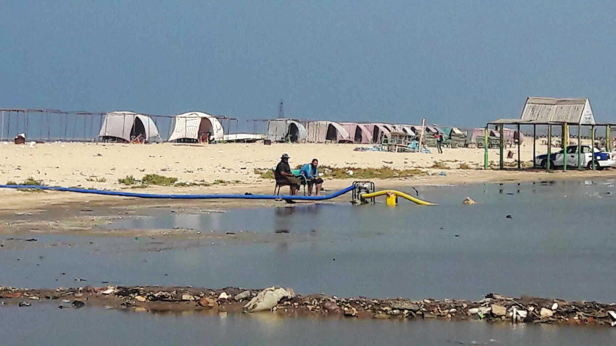 أضبط مخالفة  كارثة  مياه المجارى تصب فى شاطئ بورفؤاد ...  (2)