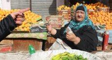 بائعة في أحد أسواق الخضروات