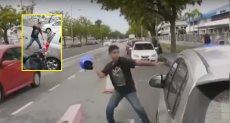 شاب يحطم سيارة امرأة حامل