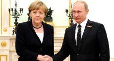 بوتين وميركل  - أرشيفية