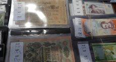 عملات قديمة بمعرض الكتاب