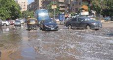 مياه الأمطار تغرق شوارع الجيزة