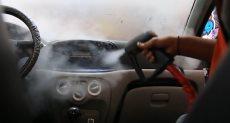 غسل السيارة بكوب ماء واحد