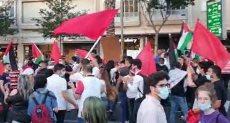 محتجون إسرائليون يرفعون علم محتجون إسرائليون يرفعون علم فلسطين فى تل أبيبفى تل أبيب