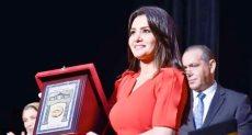 تكريم دينا فؤاد بكلية إعلام جامعة مصر