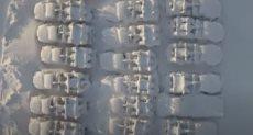 الثلوج تغطى السيارات فى المدينة الروسية