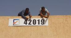 تركيب لوحات أرقام مراكز الانتخاب في ربوع ليبيا