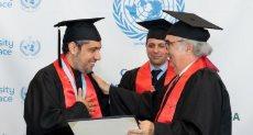 تكريم أكاديمي للدكتور العيسى من جامعة الأمم المتحدة للسلام